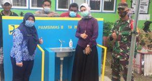 Dinas PUPR Bolmut Bersama Tim Pamsimas saat meresmikan program Pamsimas di Desa Kopi