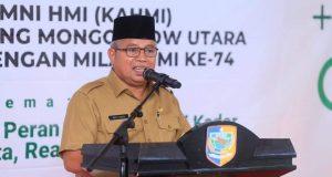Wakil Bupati Bolmut, Drs. H. Amin Lasena, MAP saat membuka secara resmi Rakerda KAHMI Bolmut